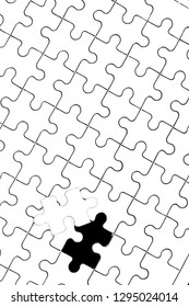 white jigsaw puzzle with one piece apart
