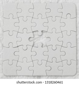 White jigsaw puzzle pieces on white background. Business concept.Puzzle without one element.
