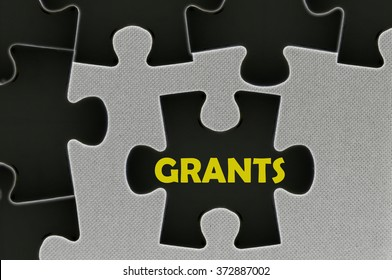 The white jigsaw puzzle written word  grants