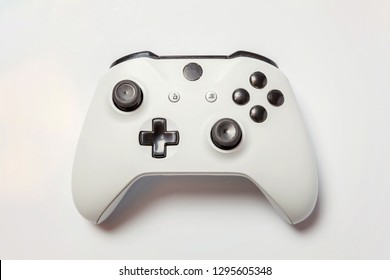 White joystick gamepad, game console isolated on white background. Computer gaming technology play competition videogame control confrontation concept. Cyberspace symbol