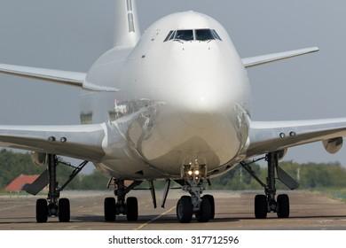 White jumbo jet taxiing after landing