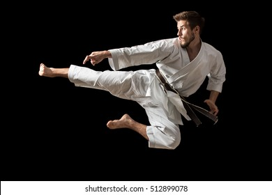 White Karate Fighter Isolated On Black