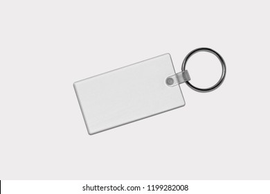white key chain mock up. Clear key chain design mock up isolated on soft gray background.. Empty souvenir holder template. blank label