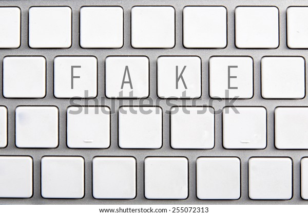 White keyboard with an inscription on the buttons: Fake