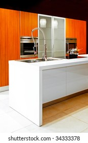 White kitchen counter with a sink and a stove