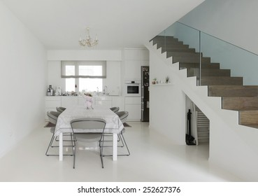 White Kitchen And Dining Room With Epoxy Floor