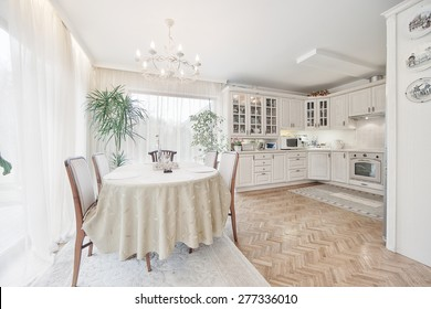 white  kitchen and dining room with  windows