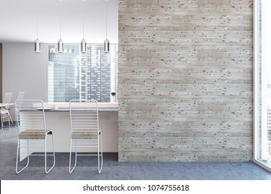 White kitchen interior with a concrete floor, white bar table and chairs standing near it. A mock up wall to the right. 3d rendering