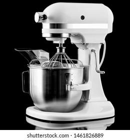 White kitchen mixer isolated on a black background