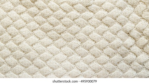 5dd26d0f95e6 White knitted carpet closeup. Textile texture off white background.  Detailed warm yarn background.