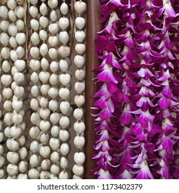White Kukui nut and purle orchid leis