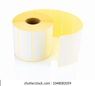 White label roll isolated on white background with shadow reflection. White reel of labels for printer. Labels for direct thermal or thermal transfer printing. Stickers on white backdrop.