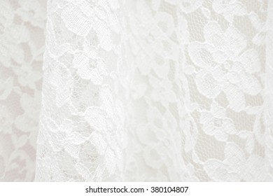 White lace with small flowers pattern, selective focus