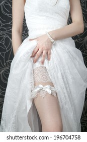 White lace stockings bride. Wedding manicure. Closeup