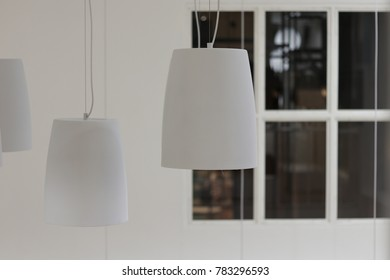 The white lamps in the room.