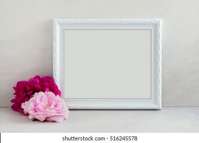 White landscape frame mock up with a 2 pink peonies beside the frame, overlay your quote, promotion, headline, or design, great for small businesses, lifestyle bloggers and social media campaigns