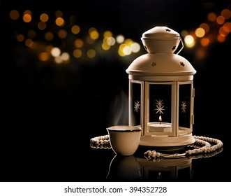 White lantern with Arabian coffee and rosary.