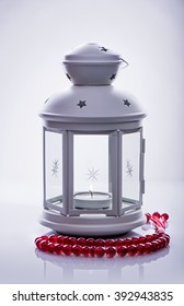White lantern with rosary