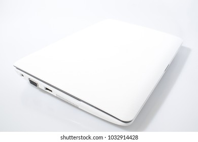 White laptop in a white background