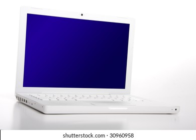 White laptop with blank blue screen. Clipping path on screen - easy paste your image into it.
