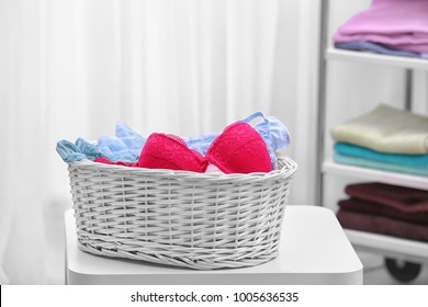 White laundry basket with underwear indoors