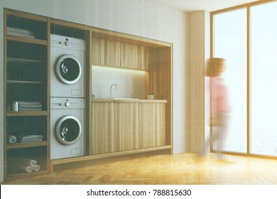 White laundry room interior with wooden countertops, a closet and built in washing machines. Side view 3d rendering mock up double exposure toned image blurred