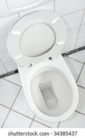 White lavatory with open lid