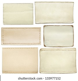White leather jeans labels, leather tags.