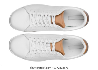 White leather male sneakers shoes on laces on white background isolation, top view
