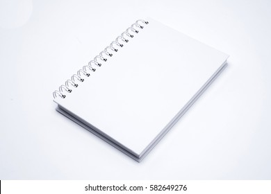 White leather notebook isolated on white background.