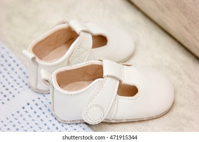 White leather the shoe for kids . The concept of waiting for a child