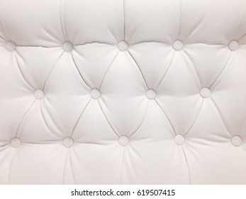 White leather sofa with buttons