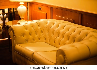 white leather sofa in hotel
