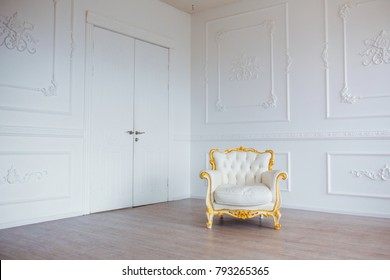 White leather vintage style chair in classical interior room