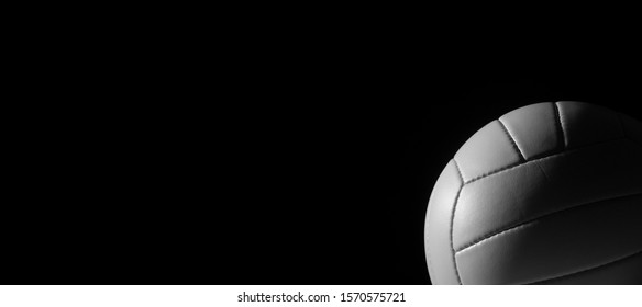 White leather volleyball detail on black background