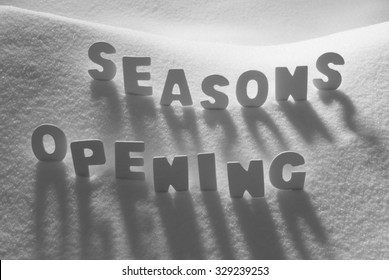 White Letters Building English Text Seasons Opening On White Snow. Snowy Landscape Or Scenery. Christmas Card For Seasons Greetings Or Usable As Background.
