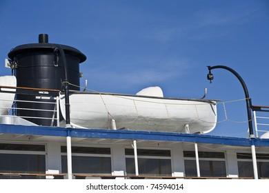 White lifeboat on a ferry boat.