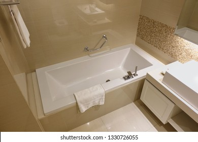 White and light brown bathroom interior with white bathtub in Luxury bathroom.