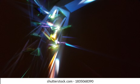 White light refracts through prisms into all the colours of the rainbow