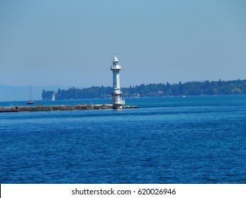 White lighthouse building in GENEVA city on alpine swiss LEMAN LAKE in SWITZERLAND with clear blue sky in warm summer day, EUROPE on JULY 2016.