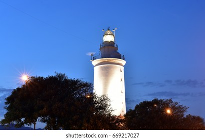 White lighthouse building port of Malaga Spain
