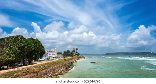 White lighthouse and Meeran Jumma Masjid mosque in old Dutch Galle fort, Sri Lanka in sunny day