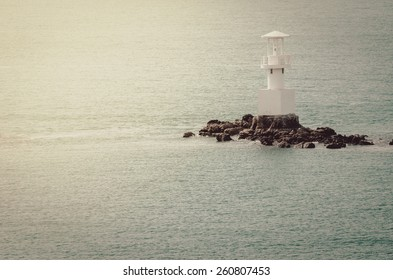White Lighthouse on the sea and blue sky in Thailand vintage