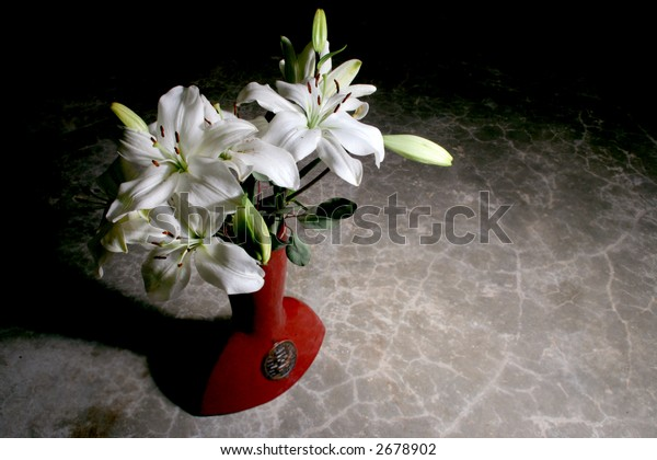 White lily bouquet in Chinese terracotta vase