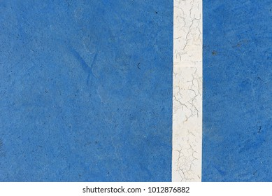 White line in concrete sport field or soccer pitch indoor.