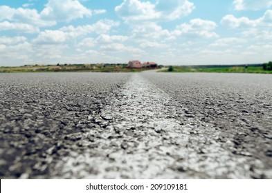 white line on asphalt road close up. soft focus