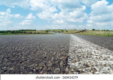 white line on asphalt road closeup. soft focus