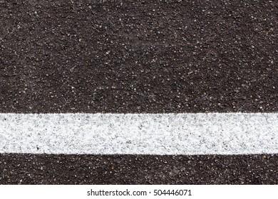 white line on black asphalt road texture background