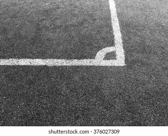 White line on a grass field background with black and white style.