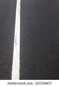 white line on road.